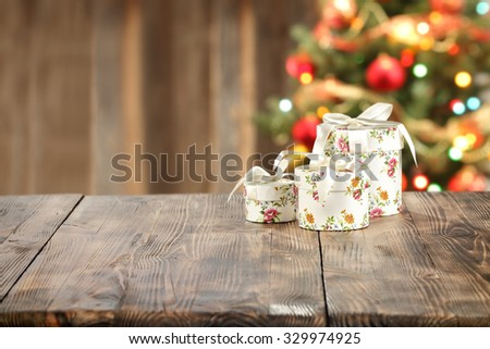 lamp and wooden table place and xmas tree  - stock photo