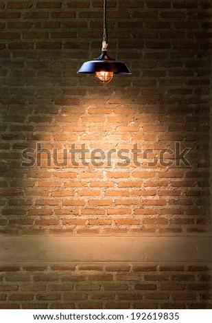 Lamp at brick wall background - stock photo