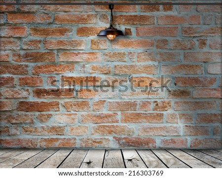 Lamp at brick wall background with ground wood, defocused brick - stock photo