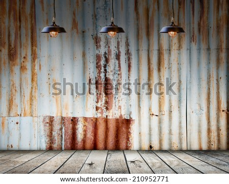 Lamp at Rusted galvanized iron plate with wood floor - stock photo