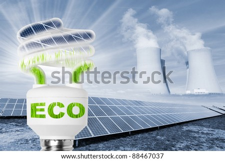 Lamp bulb with solar panels. Conceptual image. Environmental metaphor. - stock photo