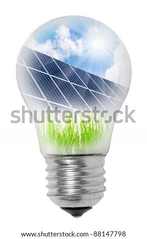 Lamp bulb with solar panels on grass. Conceptual image. Environmental metaphor. - stock photo