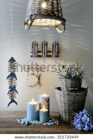 lamp ,candles,flowers,tubs and others decorative accessories in a composition