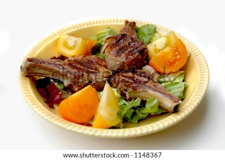 Lamp Chops on a bed of lettuce with sliced tomatoes - stock photo
