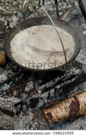 Lamp cooked in an iron cauldron outdoor in the camp