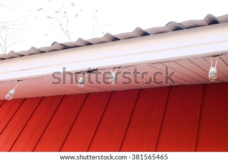 Lamp Hanging on The Red Roof