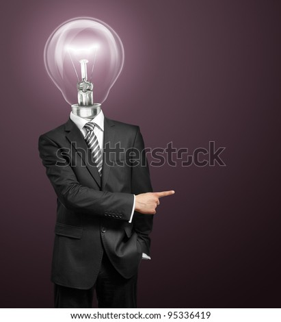 lamp head businessman have got an idea and showing with his finger to something - stock photo