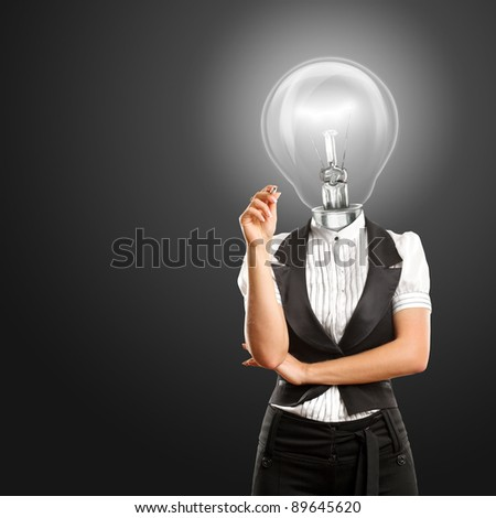 Lamp head female writing something on glass board with marker - stock photo