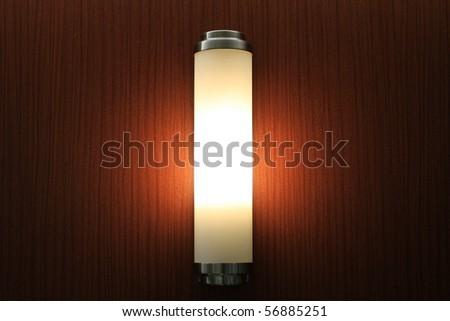Lamp in darkened room - stock photo