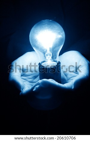 lamp in hand - stock photo
