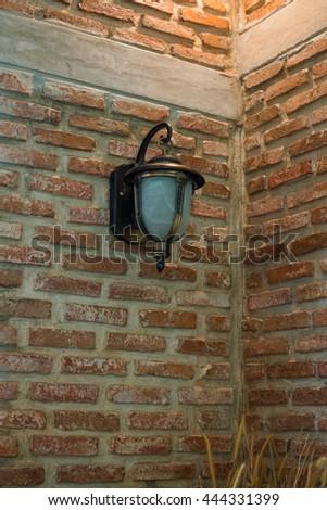lamp light on the brick wall - stock photo