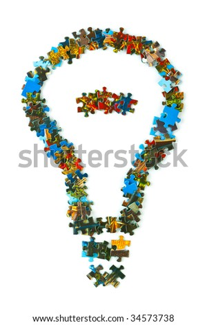 Lamp made of puzzle isolated on white background - stock photo