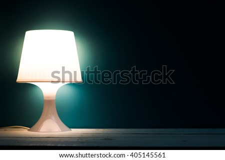 Lamp night light in a dark background. Vintage effect style picture. - stock photo