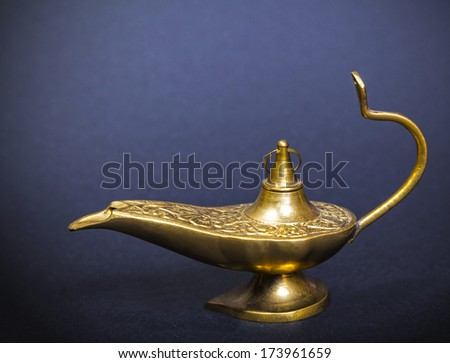 Lamp of Aladdin in dark background - stock photo