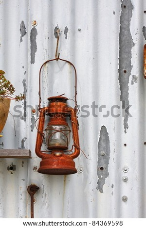 lamp, oil lamps on a rusty old corrugated iron hut - stock photo