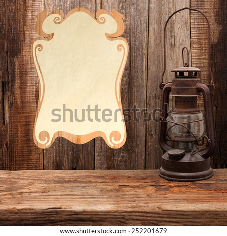 lamp oil lantern certificate old wooden table wall - stock photo