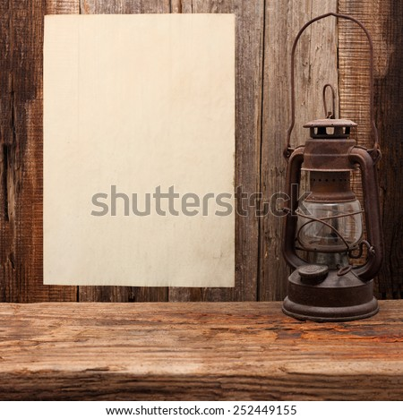 lamp oil lantern paper blank old wooden background - stock photo