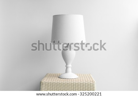 Lamp on night table next bed stock photo 325200221 shutterstock lamp on a night table next to a bed aloadofball Images