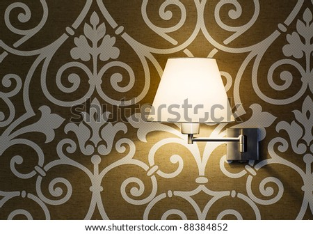 Lamp on a wall shining - stock photo