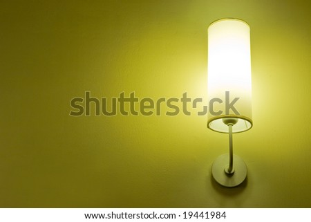 Lamp on a wall shining. Including copy space. - stock photo