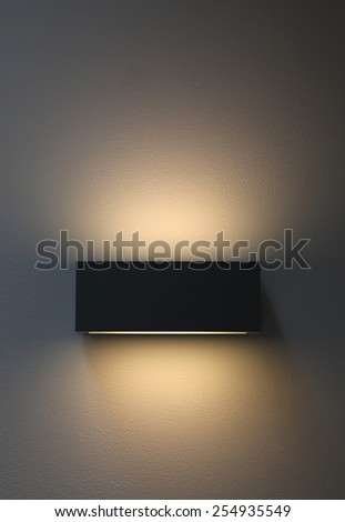 Lamp on concrete wall - stock photo