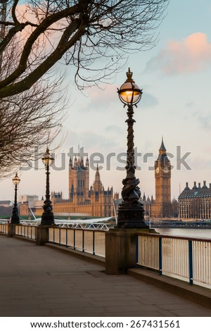 Lamp on South Bank of River Thames with Big Ben and Palace of Westminster in Background, London, England, UK - stock photo