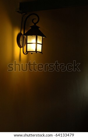Lamp on the wall. - stock photo