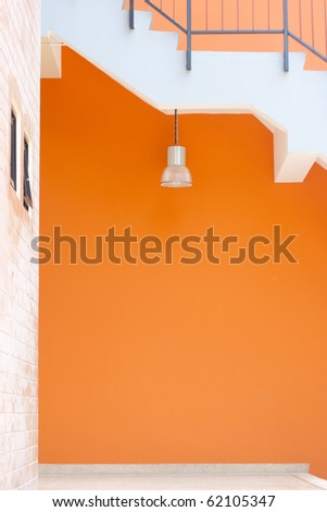 lamp & orange wall - stock photo
