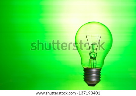 Lamp over green background as eco energy concept