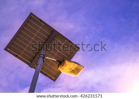 lamp post and photovoltaic panel  - stock photo