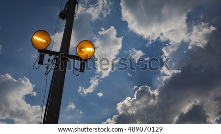 Lamp post at nightfall with clouse sky. Concept image.