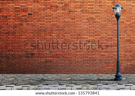 Lamp post street on brick wall background - stock photo