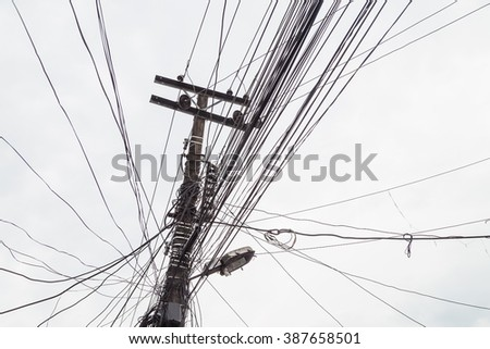 Lamp post with multiple wire connection common infrastructure in underdeveloped countries - stock photo
