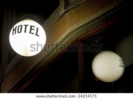 Lamp with Hotel sign reflected in a window - stock photo