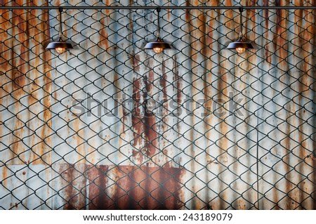 Lamp with wired fence and Rusted iron plate - stock photo