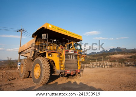 LAMPANG, THAILAND - DEC 29: coal-preparation plant. Big yellow mining truck at work site coal transportation, December, 29, 2014 in Lampang, Thailand - stock photo