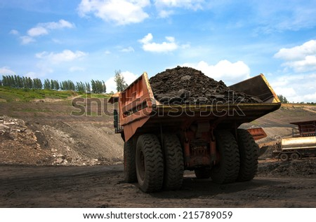 LAMPANG, THAILAND - JUNE 26: coal-preparation plant. Big yellow mining truck at work site coal transportation, June, 26, 2014 in Lampang, Thailand - stock photo