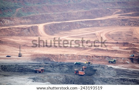 Lampang,Thailand, - on December 17,2014 : Excavator at the lignite opencast mining ,Mae Moh Lignite Mine, in northern Thailand, is the largest open-pit lignite mine in Southeast Asia. - stock photo