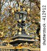 Lampost on the grounds of Buckingham Palace in London, England. - stock photo