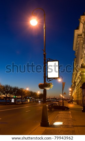 Lamppost at night waterfront - stock photo