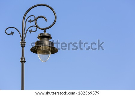 Lamppost by an old traditional design, a symbol of the old Warsaw - stock photo
