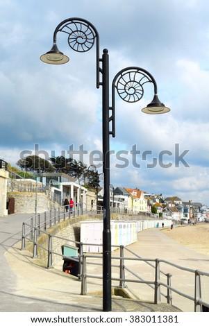 Lamppost in sahpe of nautilus shell in coastline town Lyme Regis, England - stock photo