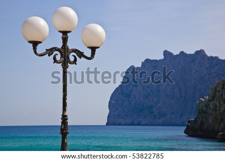 Lampposts opposite to the sea