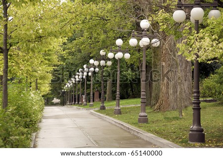 Lamps along a walkway in Old Quebec City - stock photo