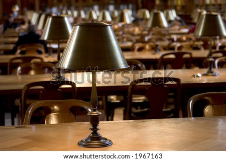 Lamps in reading room of New York Public Library - stock photo