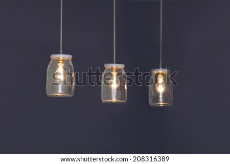 Lamps in the glass jars - stock photo