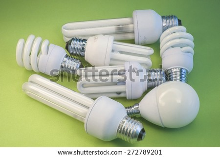 Lamps of energy saving with green background - stock photo