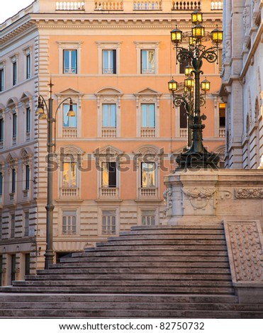 Lamps on the stairs at the back of the parliament building, Rome, Italy, beautifully lit by the first sunrays at sunset - stock photo