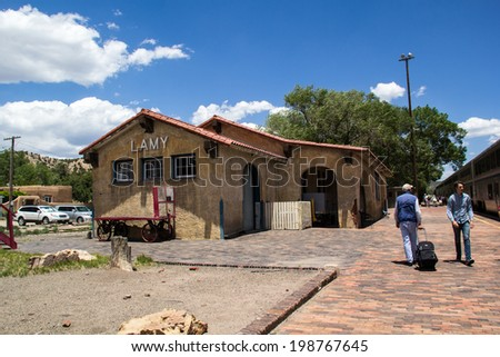 LAMY, NM, USA-JUNE 12: Passengers disembark the train at Lamy on June 12, 2014. Amtrak might bypass this historic station in the future due to track maintenance costs.