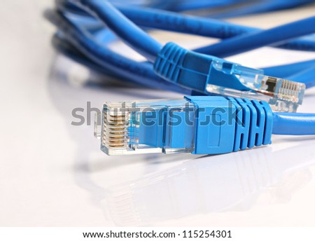 LAN blue Cat 5 Wire cable with RJ 45 Connector - stock photo